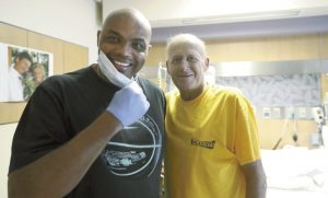 FILE - In this Aug. 31, 2016, file photo, NBA Hall of Fame member and TNT colleague Charles Barkley, left, poses with longtime NBA sideline reporter Craig Sager while visiting Sager at MD Anderson Cancer Center in Houston. Sager,  famous for his flashy suits and probing questions, has died after a battle with cancer, Turner Sports announced Thursday, Dec. 15, 2016. He was 65. (AP Photo/David J. Phillip, File)