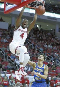 North Carolina State's Dennis Smith Jr. (4) slams in two as McNeese's Kalob Ledoux (11) watches  during the first half of an NCAA college basketball game, Thursday, Dec. 22, 2016 in Raleigh, N.C. (Ethan Hyman/The News & Observer via AP)