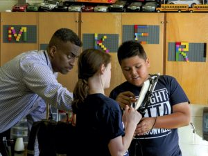 JON C. LAKEY / SALISBURY POST Anthony Johnson double checks video recording application on an i pad that Katherine Peeler and Carlos Pacheco were using for a project on the ecosystems.. The teaching style and success of Isenberg Elementary 4th and 5th grade Science and Social Studies teacher Anthony Johnson has not only students clamoring to get into his classroom but has also garnered the Rowan Salisbury School Teacher of the Year.  Thursday, December 1, 2016, in Salisbury, N.C.