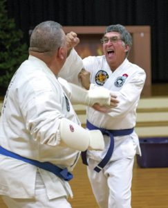 Carlin Ours, left,  and Harold Pike spar during class at Trinity Lutheran Church.  JON C. LAKEY / SALISBURY POST