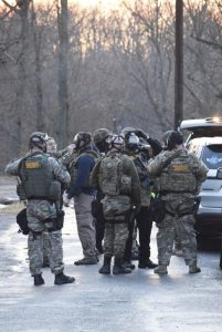 Rowan County Sheriff's deputies wait for a search warrant before entering a mobile home on East View Road in Faith. Deputies believed an armed suspect to be inside. Law enforcement fired flashbangs and teargas into the home, which proved to be empty. Rebecca Rider/Salisbury Post