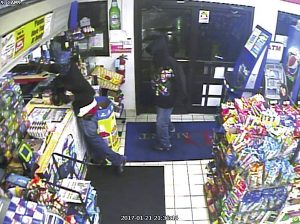 Surveillance footage from an armed robbery at DMart at 1600 S. Main St. on Saturday night at 9:38 p.m. Two suspects entered the store, pointed a gun at the clerk and had her walk to the counter. As he did this, a second clerk hit him in the back of the head with a beer can and the suspect fired the gun, grazing the clerk's arm. The suspect then grabbed the money out of the cash register and the two suspects ran from the store towards W. B Ave. The descriptions of the suspects are two black males, slim build,  age 20-30, around 5-foot-9.