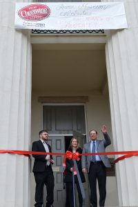 Left to right: Aaron Kelpey, Rowan Museum executive director, Joy Harper, head of marketing for Cheerwine and the great-great-granddaughter of Cheerwine's founder, L.D. Peeler and Cliff Ritchie, president of Cheerwine, stand outside the Rowan Museum for the grand opening of a Cheerwine exhibit to celebrate the drink's 100th year. Rebecca Rider/Salisbury Post