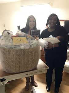 Submitted photo Smart Start Rowan director Amy Brown (left) and board chair Toi Degree (right) presented baby Jahmir Aayan Hancock with a welcome basket with items that promote reading and early learning. Jahmir was the first baby born at Novant Health Rowan Medical Center in 2017.