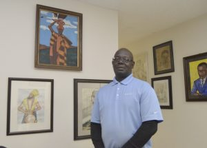 E & M Gallery co-owner Elijah Belton stands before some of his artwork that includes promient figures in black history and locally known African Americans. His work along with business partner Mickey Chambers have their work on display with featured artist Delores Medlin. The gallery is located on South Main Street in a shared space with Two Dots & a Mae Resale Store. Shavonne Walker/Salisbury Post