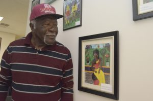 Mickey Chambers stands next to a few of his art pieces that are on display and E & M Gallery, which he co-owns with business partner Elijah Belton in a shared space with Two Dots & a Mae Resale Store on South Main Street. Shavonne Walker/Salisbury Post