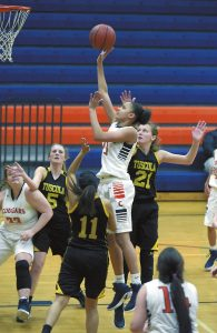 Wayne Hinshaw/for the Salisbury Post ... Carson's McKenzie Gadson (11) goes up for a shot in the lane during Tuesday night's 3A state playoff victory over Tuscola. Three Pioneers try to defend as Carson's Maren Shumaker gets into position for a possible rebound. Carson won, 58-46.
