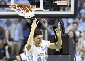 AP Photo/Gerry Broome North Carolina's Justin Jackson reacts following a dunk against Notre Dame during the second half of Sunday's college basketball game in Greensboro. The Tar Heels won that game and visit Duke tonight.