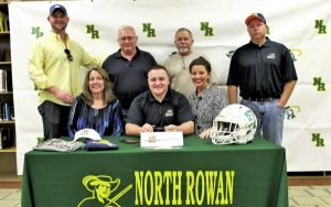 Photo courtesy of Jacqui Watson ... North Rowan's Steven Thurston signed on Wednesday to continue his education and football career at Averett University in Virginia. Shown are, front row (L-R): JeJe Thurston (mother), Steven, Amanda Sisco (sister); back row: Stephen Faley (Amanda's fiancé), uncles Dicky and Andy Thurston, and Steve Thurston (father). Feb. 1, 2017.
