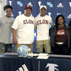 Submitted photo ... Kortez Weeks, second from right, announced his decision to continue his education and football career at Elon University, yesterday at West Rowan High School. Weeks is flanked by his family.