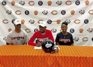 Facebook photo Brenden Westbrook, center, of Carson High School, signed recently to continue his education and football career at Catawba College. He is flanked by his father, Shaun, left, and mother, Tonya. Feb. 8, 2017.